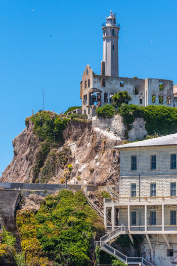 Alcatraz Built Structure Building Exterior Architecture Building Sky History Nature The Past Blue Clear Sky Travel Destinations No People Day Tower Tourism Tree Water Plant City Travel Outdoors