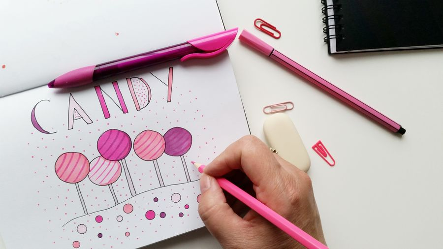 Artist Painting Pink Candy On Paper