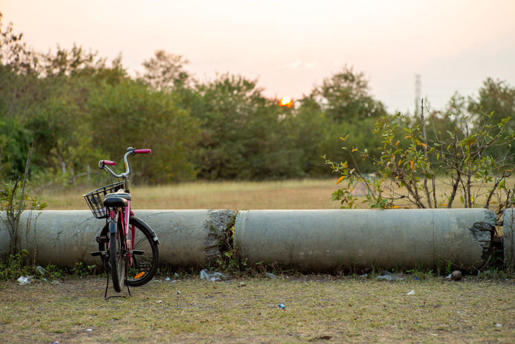 Selective focus on vintage bicycle parking at the soccer field in urban area with blurred landscape in background Plant Landscape Land Vehicle Field Grass No People Beauty In Nature Outdoors