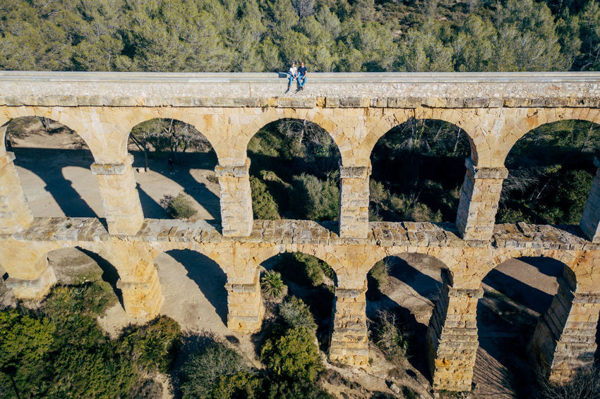 Aqueduct DJI X Eyeem Drone  The Ferreres Aqueduct Aerial Aerial View Animal Themes Arch Architecture Bridge Bridge - Man Made Structure Built Structure Day Dronephotography History Nature Old Old Ruin One Person Outdoors People Sunlight Travel Destinations Tree
