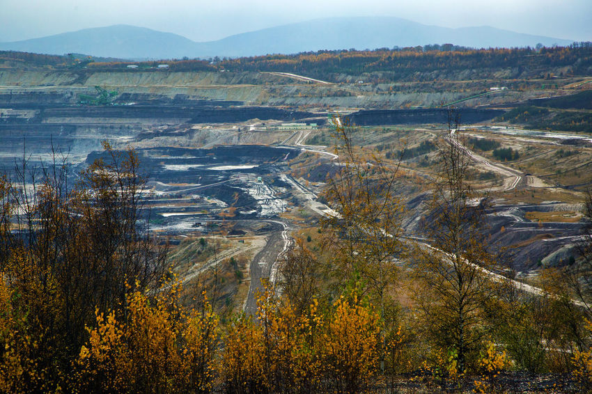 Brown Coal Mine Turów Beauty In Nature Bogatynia Day Lake Landscape Mine Mountain Mountain Range Nature No People Outdoors Scenics Sky Tranquil Scene Tranquility Tree