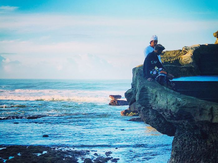 Bali Blessings Sea Sky Water Real People Horizon Over Water One Person Outdoors Leisure Activity Nature Lifestyles Full Length Cloud - Sky Rock - Object Day Sitting Beauty In Nature Beach Scenics Men Young Adult