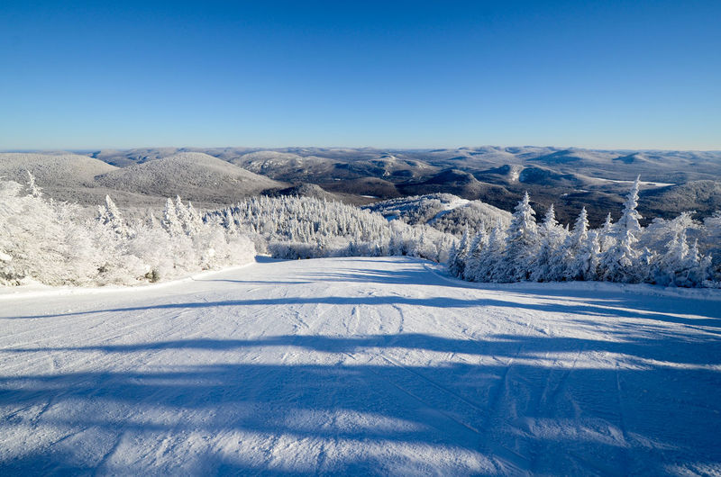 Mont Tremblant, Qc Beauty In Nature Blue Clear Sky Cold Temperature Copy Space Day Idyllic Landscape Mountain Mountain Range Nature No People Outdoors Scenics Sky Snow Sunlight Tranquil Scene Tranquility Tree White Color Winter