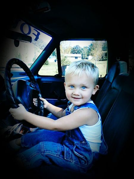 Car Transportation Car Interior Vehicle Interior Childhood One Person Steering Wheel Sitting Land Vehicle Vehicle Seat People Driving Portrait Looking At Camera Child Journey Indoors  Road Trip Day Real People BabyBlueEyes