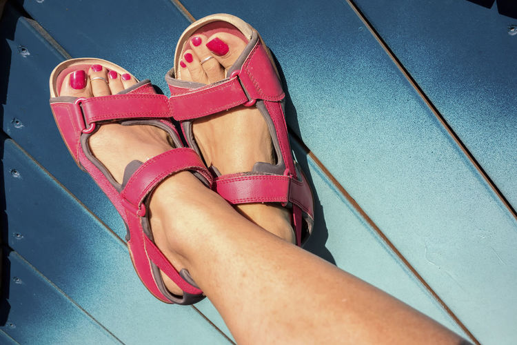Crossed feet. Foot Nail Polish Nails Sandals Crossed Feet Feet Feet Above Feet In The Air Feetselfie Foots Footwear Joy Laying Legs Legs Above Lifestyles Low Section Personal Perspective Pink On Blue Pink Sandals Toenails Toes