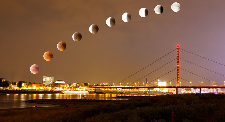 Lunar eclipse with blood moon over old town of Duesseldorf Düsseldorf Lunar Eclipse Blood Moon Bridge Built Structure Mondfinsternis Nature Sky