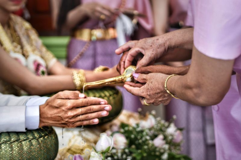 People Performing Traditional Cultures During Wedding Ceremony