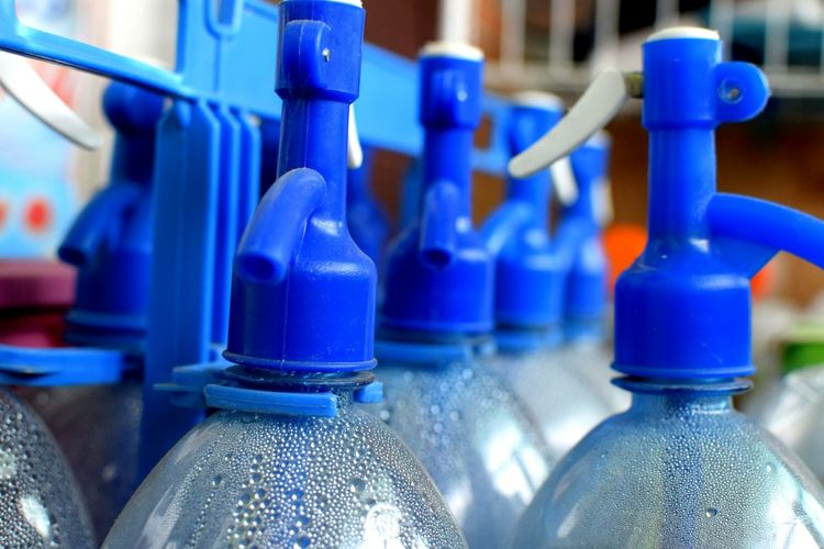 Close-up Of Spray Bottles