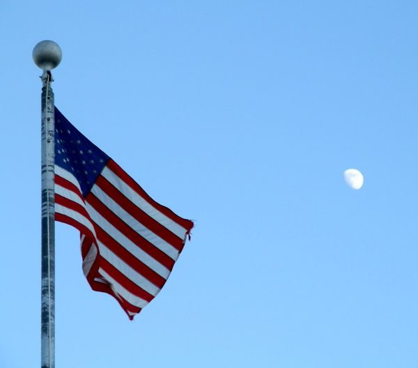 American Flag with the Moon Striped Patriotism Low Angle View No People Flag Blue Flying Day Outdoors Sky Clear Sky Summer Check This Out! Outdoor Photography Wisconsin Cloud - Sky Moon Moon Shots Moon_collection USA FLAG USA Patriotic, Patriot, Flag, American Flag, Honor, Respect Patriotism