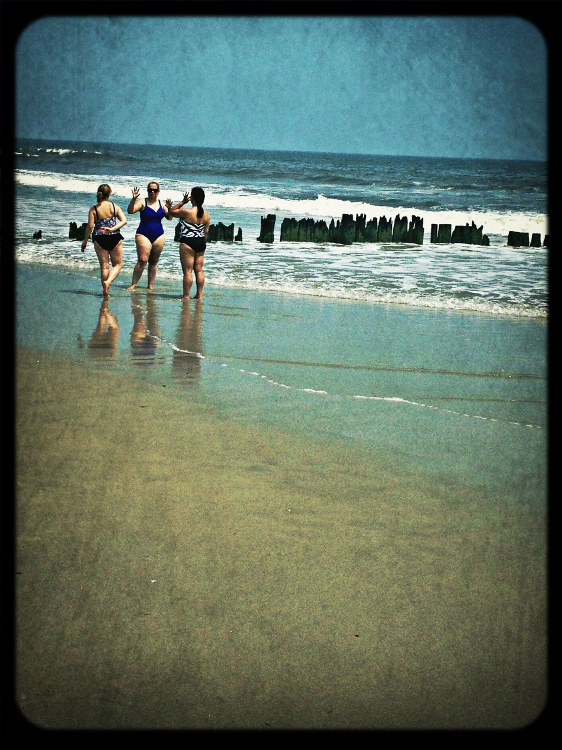beach, sea, water, transfer print, sand, shore, horizon over water, auto post production filter, wave, vacations, leisure activity, lifestyles, surf, sky, nature, coastline, large group of people, scenics, beauty in nature