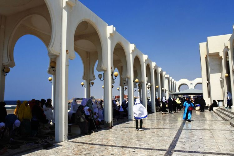 Jeddah, SAUDI ARABIA - MArch 08 2017: Masjid Ar-Rahmah (Floating Mosque), Red Sea. Arch Architectural Column Architecture Building Exterior Built Structure Clear Sky Day In A Row Large Group Of People Lifestyles Men Outdoors People Real People Sky Sunlight Travel Destinations