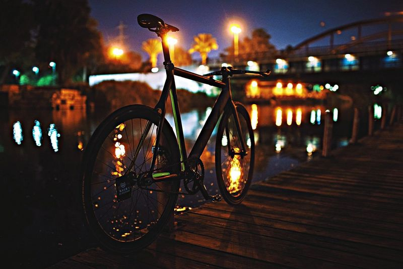 Bicycle leaning against wooden post on jetty