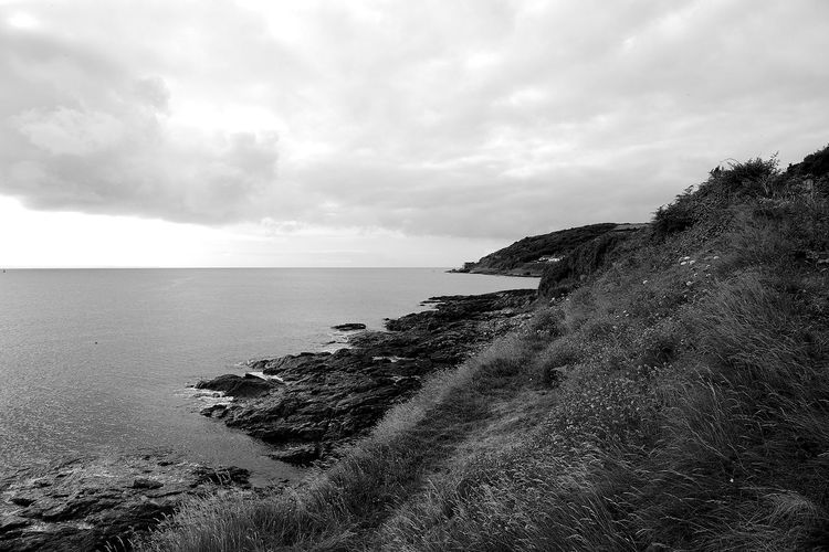 Stormclouds Over Mousehole Coastline Beach Beauty In Nature Blackandwhite Cloud - Sky Horizon Horizon Over Water Land Nature Scenics - Nature Sea Sky Tranquil Scene Tranquility Water