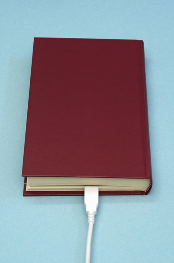 Close-up of red open book on table
