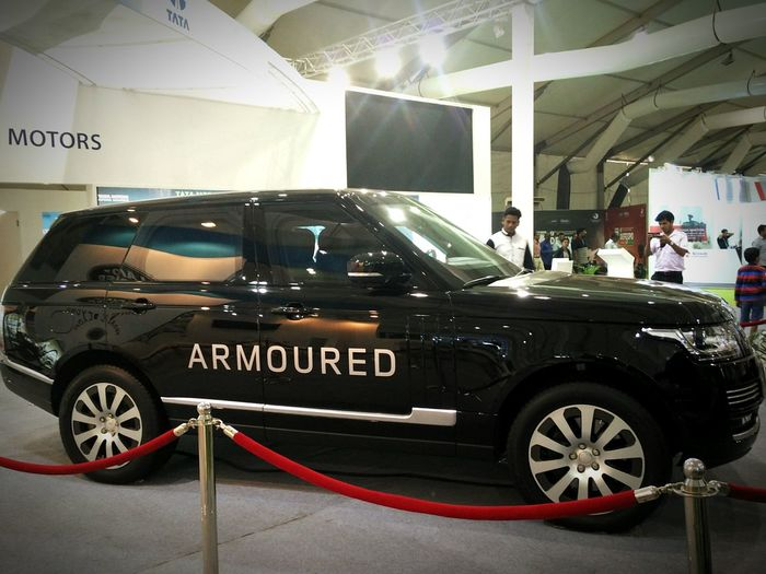 Armoured Range Rover Sentinel kept for display by TATA Motors at Defexpo India 2016 in Goa. Armoured Vehicle Range Rover Range Rover Sentinel Black Suv Indian Army Defence Defence Exposition Defence Expo Goa Goa India Car SUV Vehicle Automobile Public Display Exterior Side View Protected Black