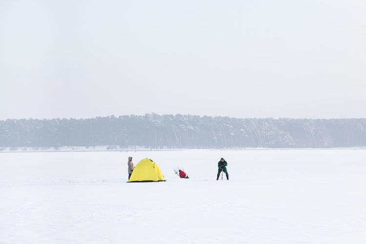Ice camping at Zalew Zemborzycki lake near Lublin, Poland Camping Cold Temperature Drill Drilling Eastern Europe Family Family Time Fishing Frozen Lake Frozen Water Horizon Ice Ice Camping Ice Fishing Landscape Lublin People Poland Polish Winter Snow Snow Covered Tent Rocks Three Colours Winter Winter Camping