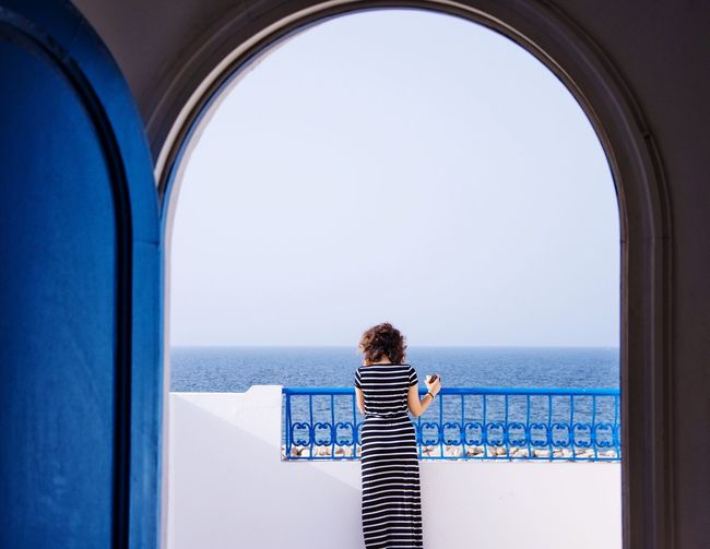 The Portraitist - 2016 EyeEm Awards Portrait Of A Woman Looking Into The Future Looking Forward Beautiful View Sea And Sky Balcony Balcony View Relaxing Coffee Time Door White Blue Stripes Fashion Pretty Girl Arabic Style Arabic Coffee