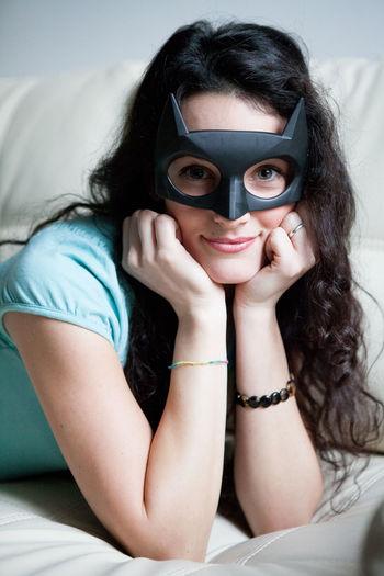 A girl on a couch smile with a batman mask Batgirl Batman Mask Batwoman Beauty Beauty Girl EyeEm Best Edits EyeEm Best Shots EyeEm Gallery EyeEmBestPics Girl Woman Young Women