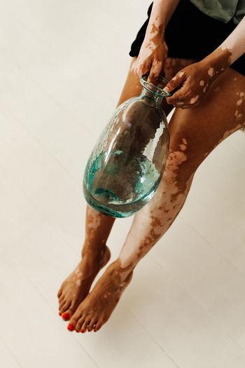 Human Body Part One Person Low Section barefoot Human Leg Human Hand Real People Body Part Indoors  Hand Men Lifestyles Flooring Adult Human Foot High Angle View Water Studio Shot Human Limb Vitiligo