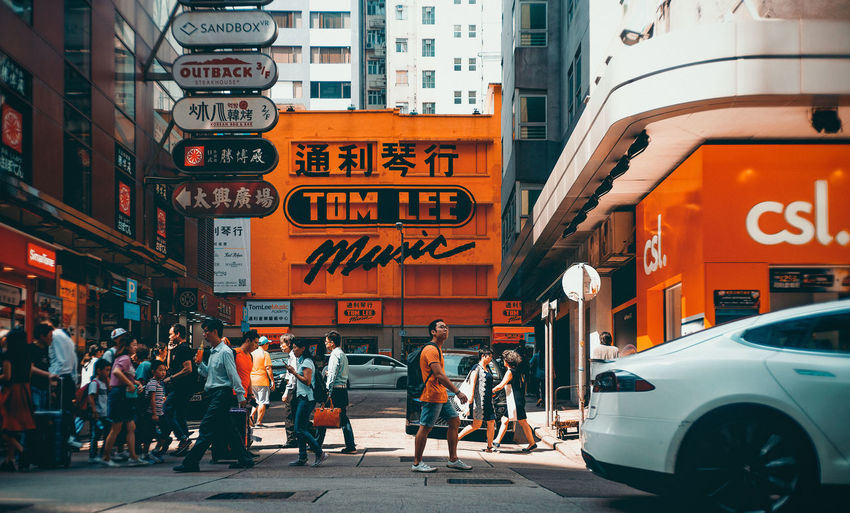 Hk City Transportation Mode Of Transportation Building Exterior Architecture Built Structure Car Motor Vehicle Street Land Vehicle Group Of People Text City Life Real People Road Men City Street Crowd Communication Women Outdoors