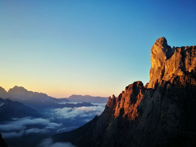 enrosadira al Sass Maor Dawn Enrosadira Pale Di San Martino Dolomites, Italy Primiero Mattina Presto Mountain Mountain Peak Sky Landscape Mountain Range Cliff Rock Formation Rock - Object Natural Landmark Geology Rock Face Hiker