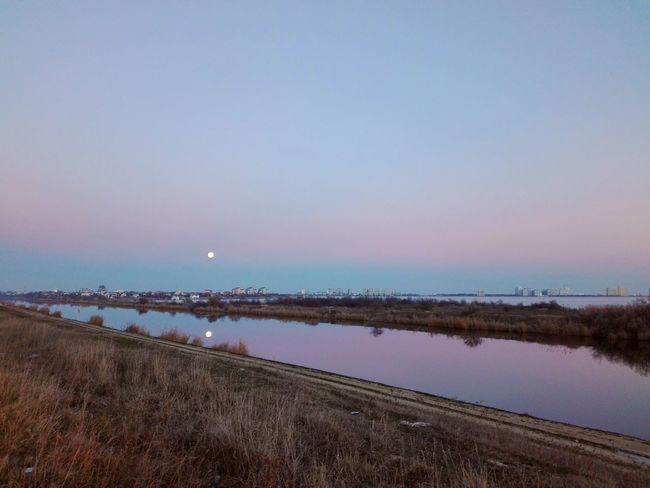 view of moon Water Reflection Beauty In Nature Outdoors Lake Nature Scenics Sky Beach No People Bird Horizon Over Water Day