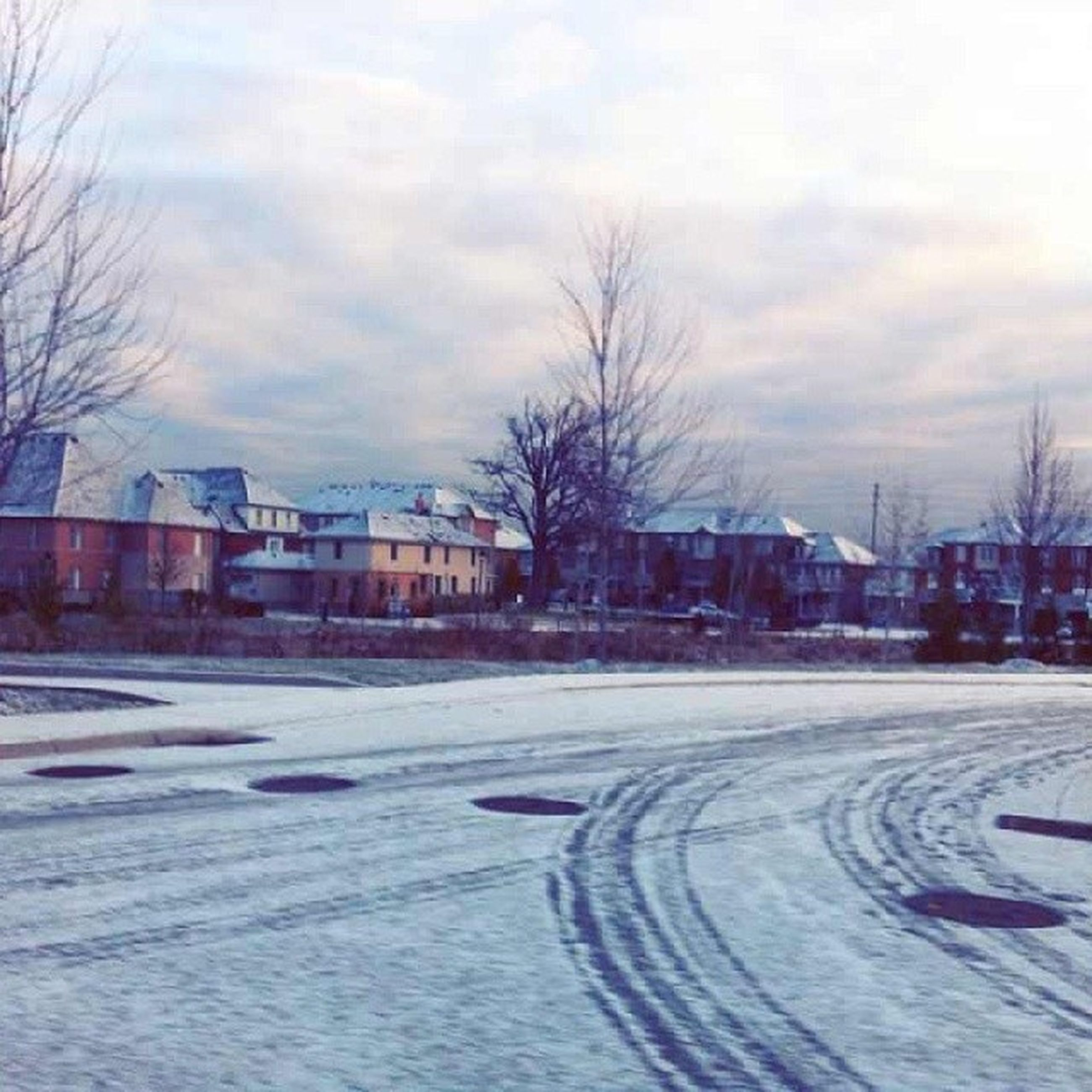 snow, winter, cold temperature, bare tree, building exterior, weather, architecture, built structure, sky, season, city, cloud - sky, street, road, tree, transportation, covering, cloudy, car, frozen