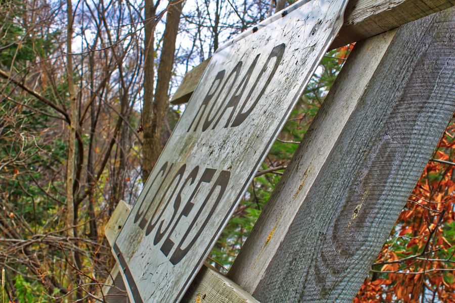 Road closed sign discarded or abandoned in autumn foliage in Wisconsin. Autumn Discarded Sign Abandoned Architecture Building Exterior Built Structure Close-up Day Focus On Foreground Foliage Forest Land Leaning Nature No People Outdoors Plant Railing Road Closed Road Closed Sign Tree Tree Trunk Trunk Wood - Material