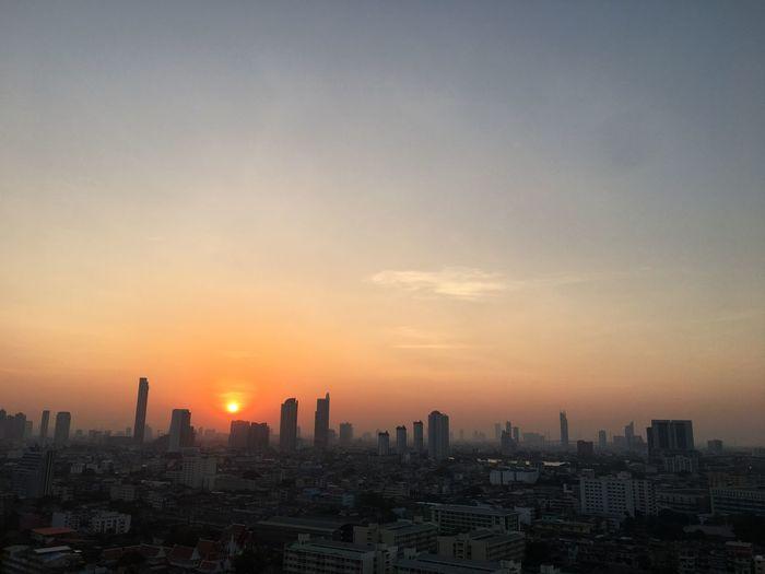Sunrise #sun #sky #cloud #beautifulnature Bangkok Thailand Bangkok Thailand Golden Light EyeEm Selects #Sunrise Goldensky #Nature  Building Exterior Architecture Sky Built Structure City Building Nature Cityscape Urban Skyline Orange Color City Life Cloud - Sky Skyscraper
