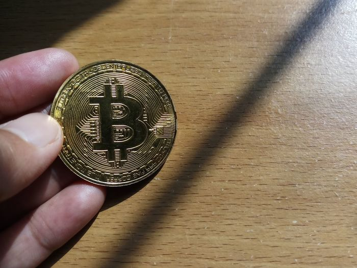 Golden bitcoin Bitcoin Golden Golden Bitcoin Gold Bo Digital Currency Cryptocurrency System Coin Ligth Miner Shadow Human Hand Human Body Part Human Finger Holding One Person Close-up Indoors