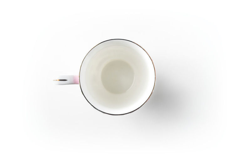 Directly above shot of coffee cup over white background