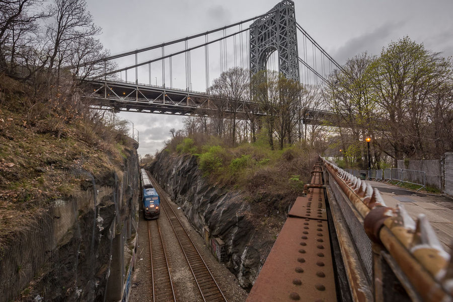 Architecture Bridge Bridge - Man Made Structure Built Structure Connection Day Engineering Land Vehicle Mode Of Transport No People Outdoors Public Transportation Rail Transportation Railroad Bridge Railroad Track River Sky Suspension Bridge The Way Forward Train - Vehicle Transportation Travel Travel Destinations Tree Water