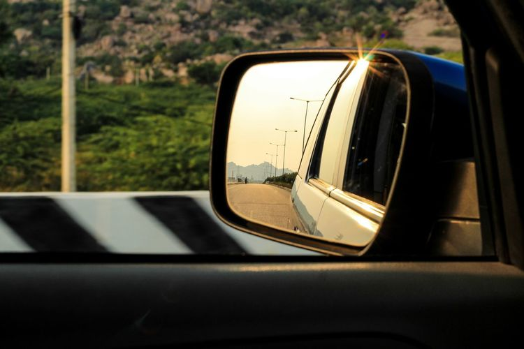 Mode Of Transportation Transportation Car Motor Vehicle Land Vehicle Side-view Mirror Reflection Glass - Material Travel No People Close-up Mirror Outdoors Road Day Motion Vehicle Interior Rear-view Mirror Window Vehicle Mirror Road Trip