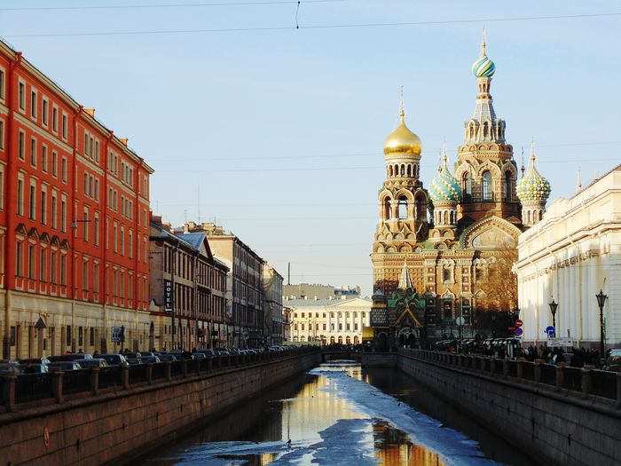 Church of the savior on blood by canal against sky in city during winter