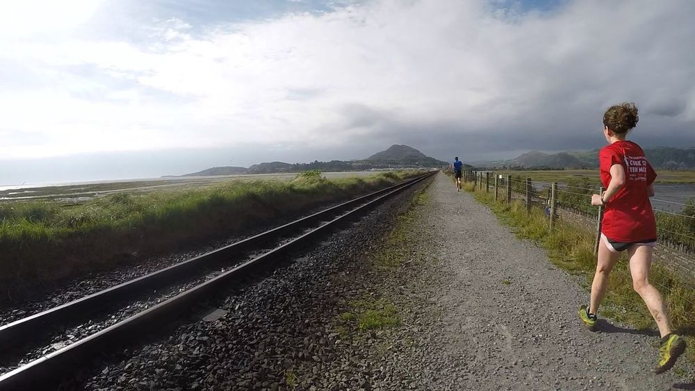 Railroad Track Transportation The Way Forward Leisure Activity Casual Clothing Lifestyles Cloud - Sky Standing Sky Landscape Diminishing Perspective Rail Transportation Full Length Vanishing Point Half Marathon Person Tranquil Scene Mountain Nature Outdoors People And Places Running Exercise Trail Running Wales