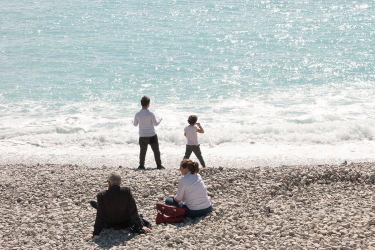 Rear view of women on beach
