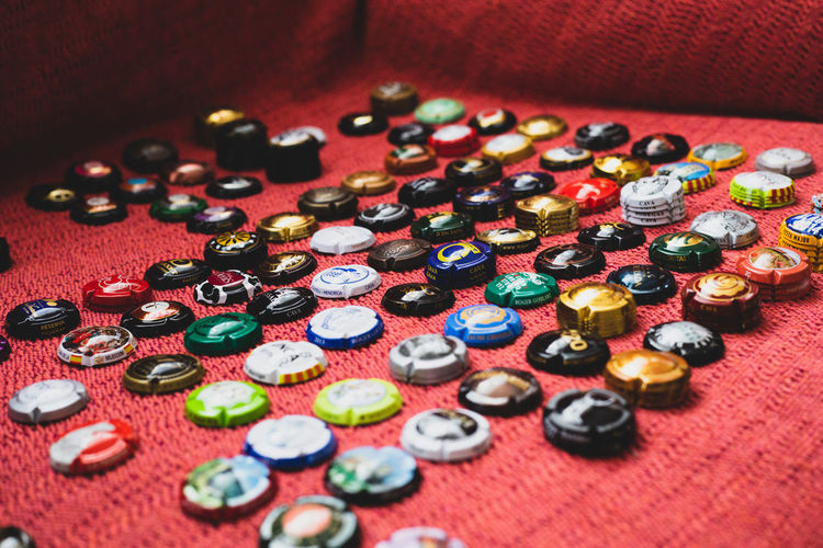 High angle view of colorful bottle caps on table