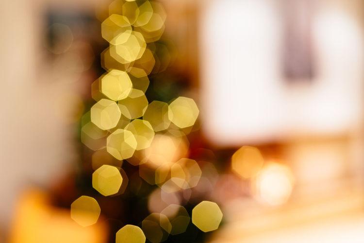 Defocused image of illuminated christmas tree