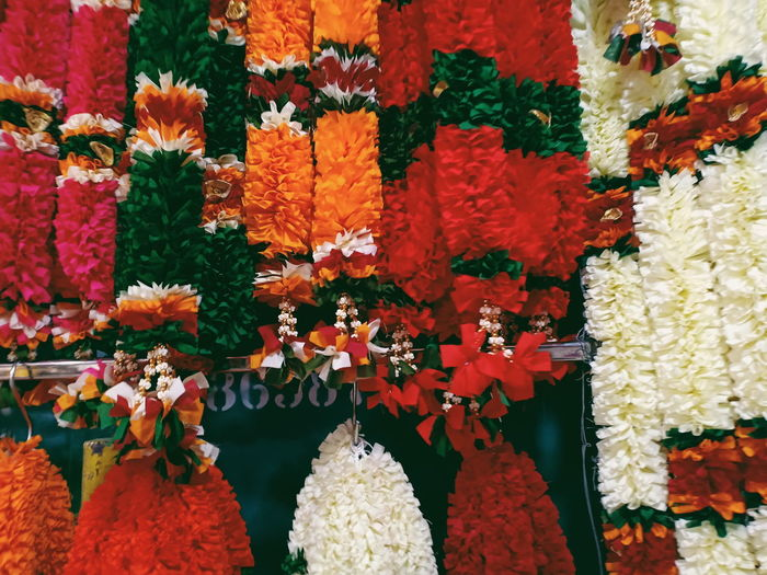 Close-up of multi colored flowers in market for sale