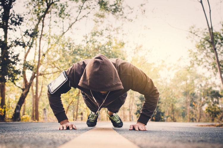 Man exercising on road