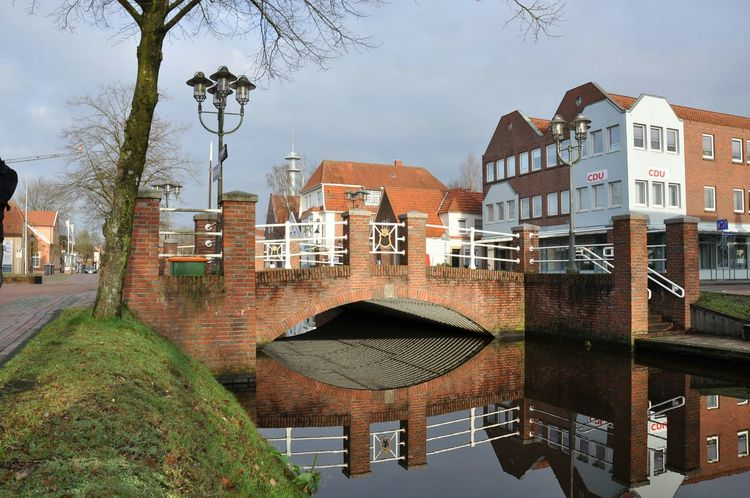 Papenburg Bridge Reflection_collection Reflection Brücke Bridge EyeEm Deutschland Reflected Glory Architecture_collection Architecture Spiegelung Building Exterior Built Structure House Water Residential Building Outdoors Day Tree No People Sky Nature City
