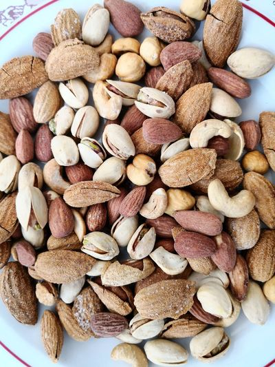 Mixed nuts with aperitif Snack Time! Mixed Nuts Nuts Snack EyeEm Selects Nut - Food Peanut - Food Dried Fruit Close-up Food And Drink Hazelnut Almond Cashew Pistachio Nutshell Date Walnut Nut Sunflower Seed