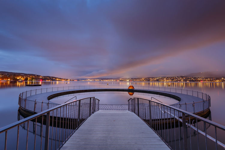 Good morning zurich Architecture Beauty In Nature Bridge - Man Made Structure Building Exterior Built Structure City Cloud - Sky Illuminated Nature Night No People Outdoors Railing Scenics Sea Sky Sunset The Way Forward Tranquility Water