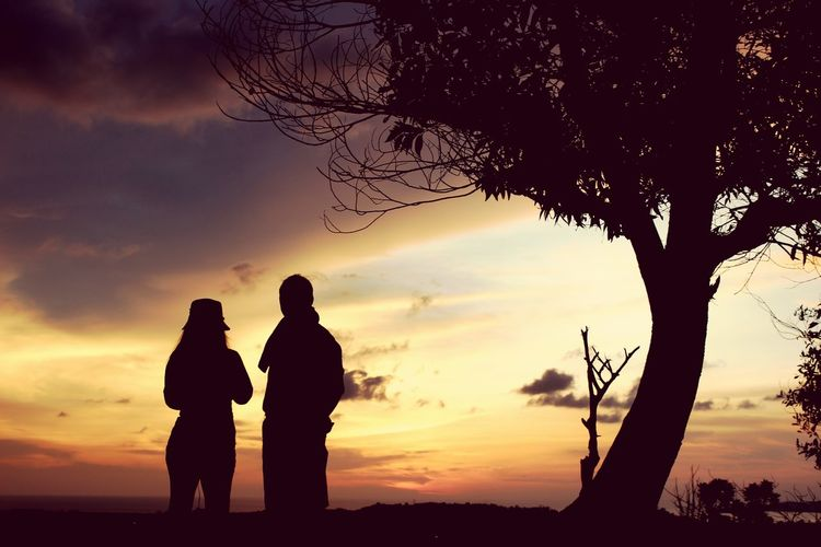 Love never fails.Silhouette Sunset People Night Vacations Nature Outdoors Adult Tree Sky Togetherness Water Adults Only Couple EyeEmNewHere Illuminated Sunset Silhouettes TCPM Silhouette Art Is Everywhere Urbanphotography Sunset_collection Lights