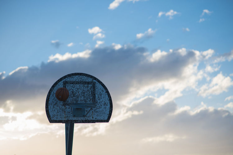 Above the rim Basketball Basketball - Sport Basketball Hoop Beauty In Nature Blue Circle Cloud - Sky Day Low Angle View Nature No People Outdoors Shape Sign Sky Sport Sunset