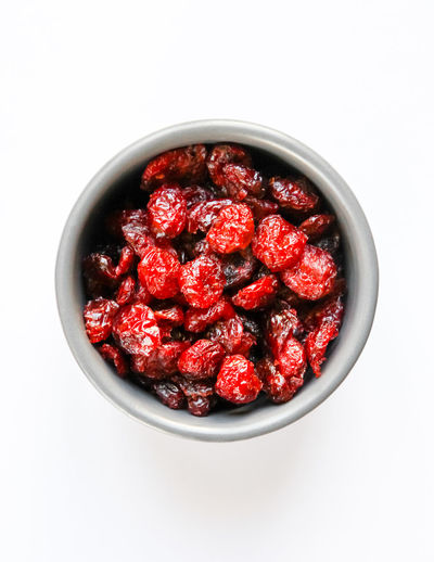 Directly above shot of strawberries in bowl against white background
