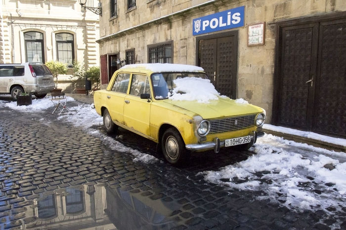 Soviet Car in Old City Brick Ways Paint The Town Yellow Snow ❄ Vaz 2106 Winter Car Land Vehicle Mode Of Transport No People Police Department Post Snowstorm Rain Reflection Snow Street Streetphotography Taxi Transportation Winter Yellow