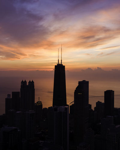 Wake up Chi Building Exterior Sunset Sky Architecture Built Structure Building City Cloud - Sky Orange Color Cityscape Office Building Exterior Skyscraper No People Tower Nature Urban Skyline Modern Silhouette Tall - High Landscape Outdoors Spire  Financial District  Romantic Sky