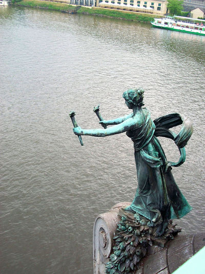 Statue against water
