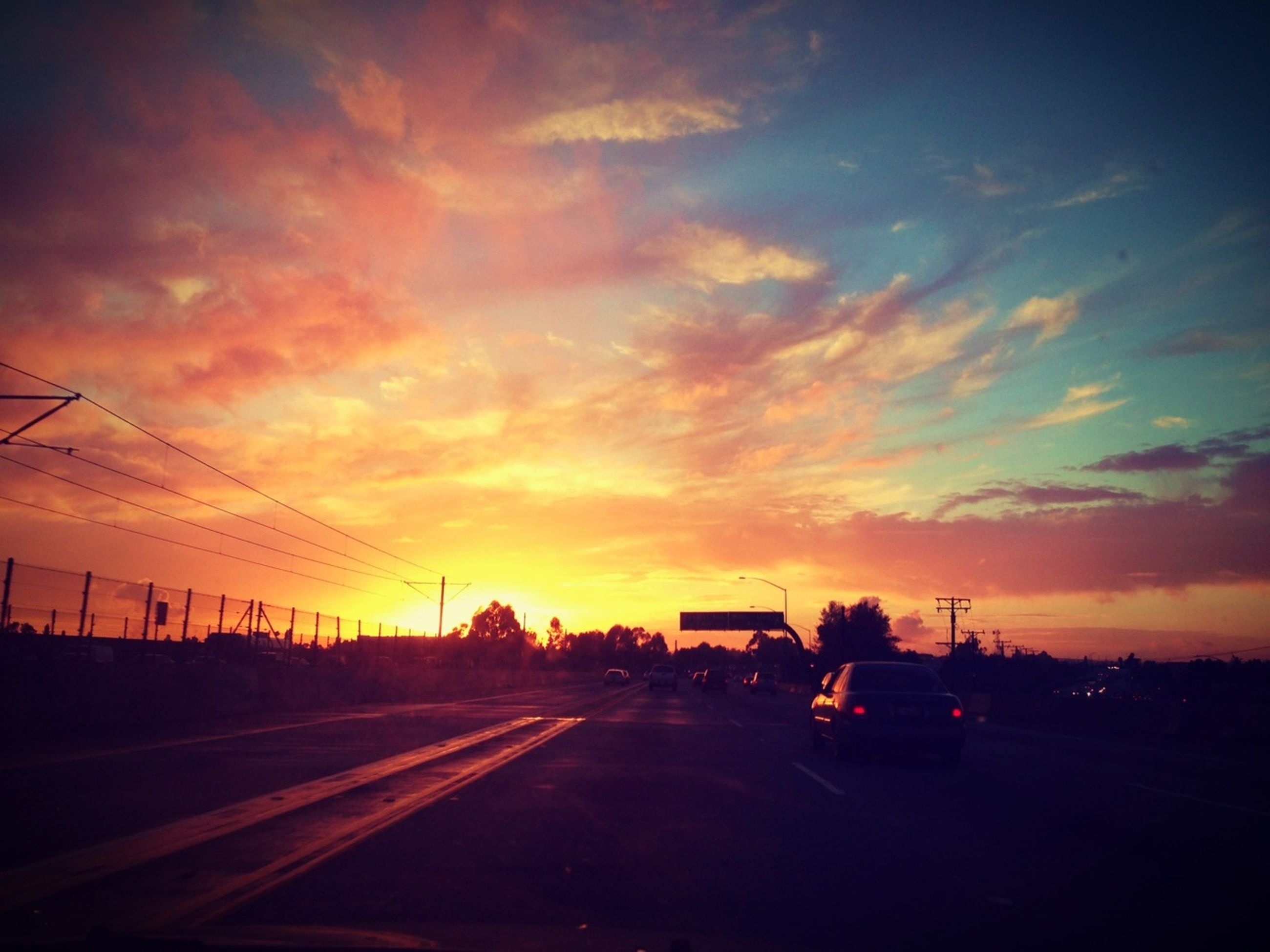 sunset, transportation, orange color, sky, sun, land vehicle, car, road, silhouette, mode of transport, cloud - sky, scenics, dramatic sky, landscape, beauty in nature, nature, the way forward, tranquil scene, sunlight, tranquility